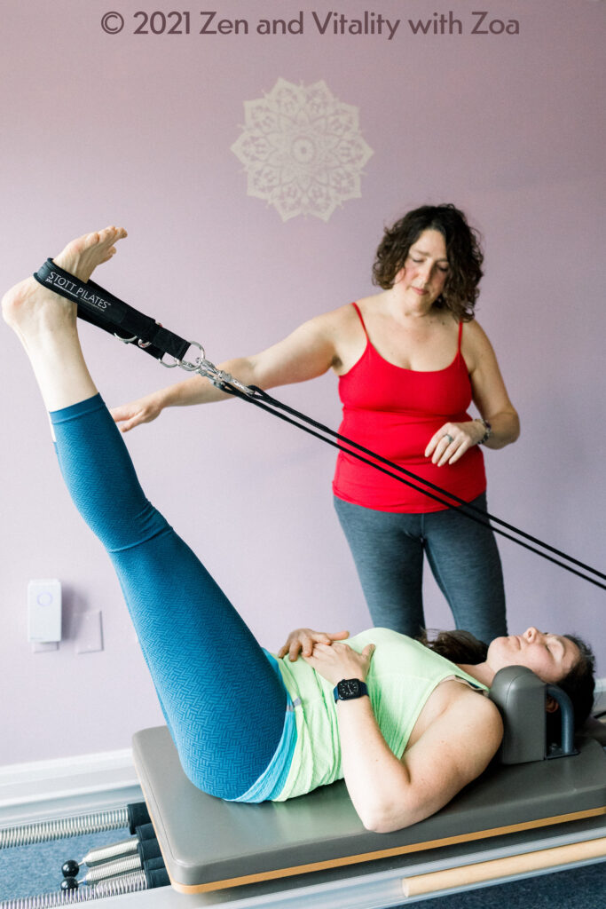 Zoa instructing Lift and Lower on the Pilates Reformer