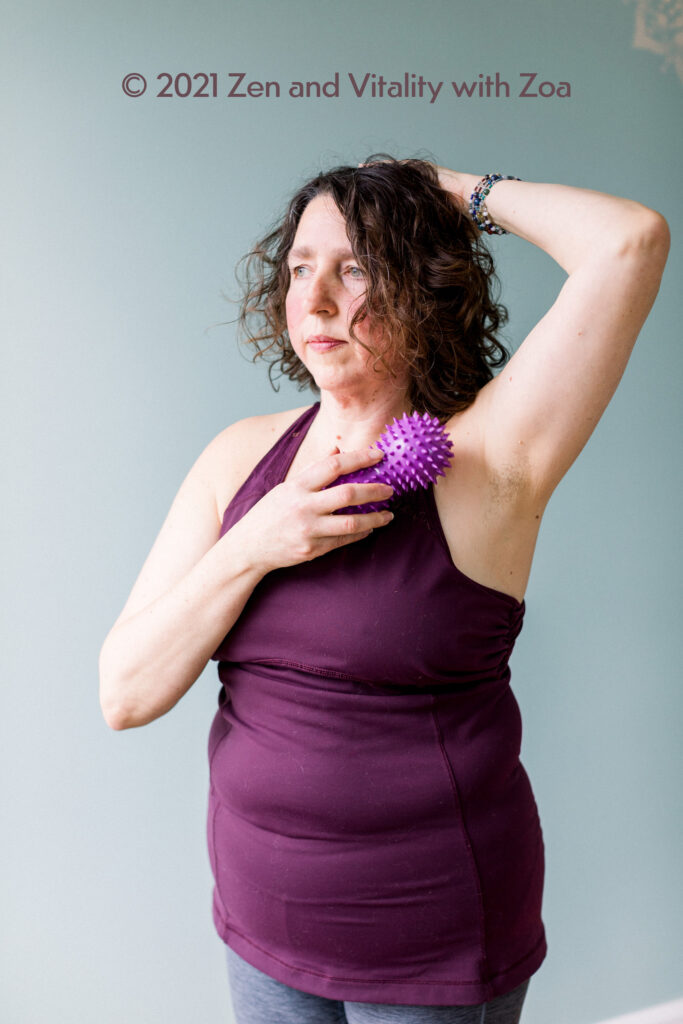 Zoa Conner, PhD receiving a fascial release of her chest with a purple peanut