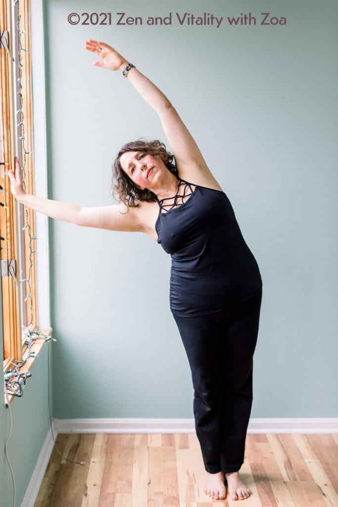 Zoa practicing a yoga asana - crescent moon