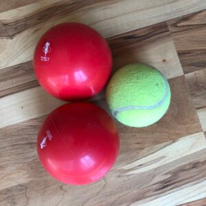 Red balls for fascial stimulation and release from Franklin Method